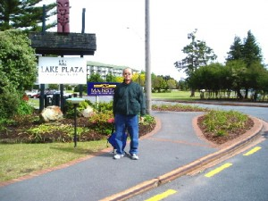Writer in front of Lake Plaza Hotel signboard