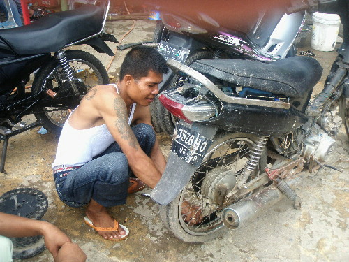 A Roadside Motorcycle Repairer