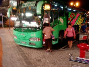 Boarding a green bus at Hong Kong International Airport