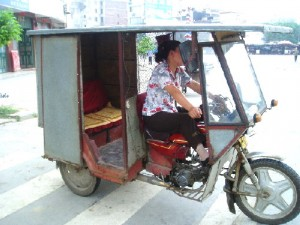 A motorised tricycle used as a taxi in Hezhou City