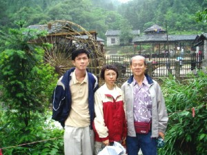 Writer's son(left), wife(centre) and himself(right) at a winery in Gu Po Mountain