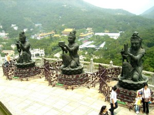 Three of the six statues of pretty ladies making an offering kneeling in front of Tian Tan Buddha