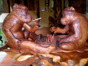 Carved wooden monkeys playing chess