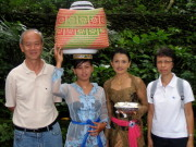 Writer and his wife posing with Balinese ladies