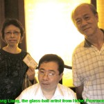 Writer and his wife posing with the artist, Gong Liang