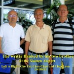 Writer(centre) and his two brothers