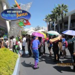 "Long queue in hot sun outside ""Astro Blasters"""