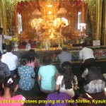 Buddhists devotees praying at Yele Pagoda