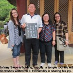 Johnny Swee and family make a temple donation