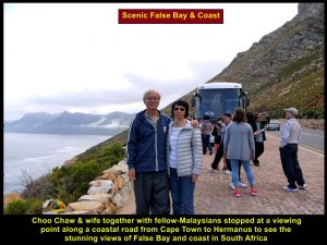 Choo Chaw and wife together with others at a lookout point to see scenic False Bay and coasts