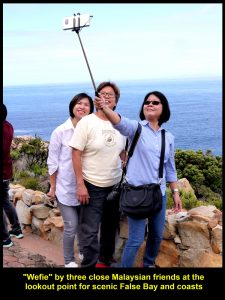 "Three close Malaysian friends doing ""wefie"" at lookout point fpr False Bay and coasts"