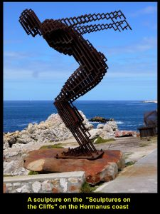 Sculpture of a tall steel man at Gearing's Point in Hermanus