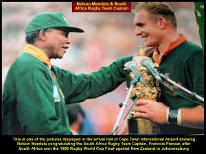 A picture of Nelson Mandela congratulating the S. Africa rugby team captain for winning the 1995 Rugby World Cup Final