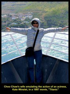 """My wife, seemingly, on a ship, """"Titanic"""", emulating the action of Kate Winslet"""