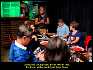 A waitress talking about South African food before it was served