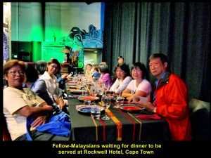 Malaysians waiting, patiently, for dinner to be served