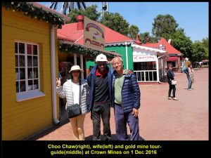 Choo Chaw and wife taking a photo with the gold mine tour-guide at the mine museum