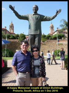 A fellow-Malaysian couple standing in front of the tall statue of Nelson Mandela, Union Buildings, Pretoria