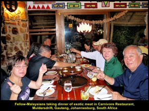 Fellow-Malaysians at the last table were in happy mood before the dinner of exotic meat at Carnivore Restaurant