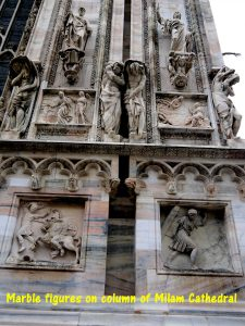Marble figures on column of Milan Cathedral