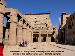 Courtyard of Ramesses II in the foreground and the Tripartite Shrine in the background in the Temple of Ramesses II