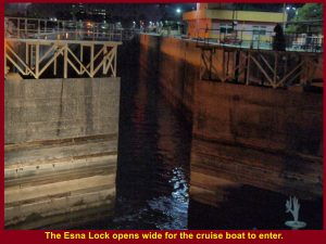The lower gate opens wide for the cruise boat to enter.