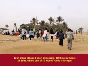Tour group stopping at an Elim oasis to see one of 12 Moses' wells