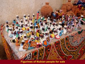 A souvenir stall selling figurines of Nubian people