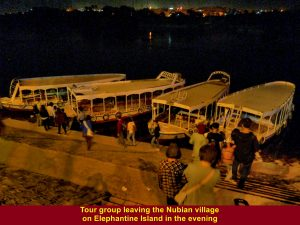 Tour group leaving the Nubian village in a motor-boat