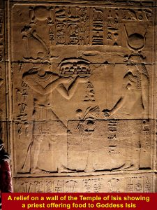 A relief at the Temple of Isis showing a priest offering food to Goddess Isis