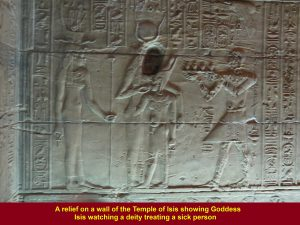 A relief at the Temple of Isis showing Goddess Isis watching a priest treating a sick person