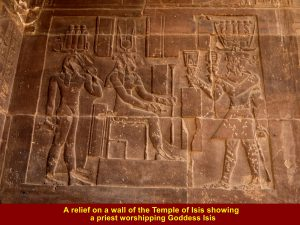 A relief showing a priest worshipping Goddess Isis