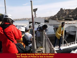 Tour group leaving Agilkia Island by boat
