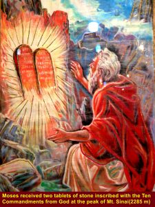 Moses on the Mi. Sinai summit receiving two tablets of stone inscribed with the God's Ten Commandments, according to the Book of Exodus