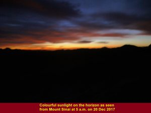 Colourful sunlight on the horizon at 5 a.m. as seen from a rest shelter on Mt. Sinai