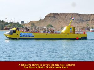 A tourist submarine moving to the deep water of Naama Bay