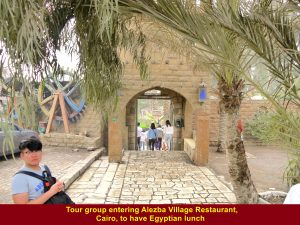 Tour group entering Alezba Village Restaurant in Cairo to have Egyptian lunch