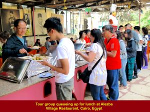Tour members queuing up for buffet lunch at Alezba Village Restaurant, Cairo