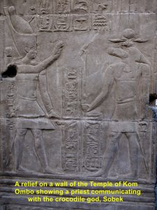 A wall-relief showing a priest communicating with the crocodile god, Sobek