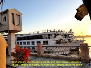 Tour group cruise boat on River Nile, Edfu, Egypt