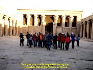 Tour group in Peristyle Hall facing the Hypostyle Hall of the Temple of Horus