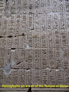 Heiroglyphs on a wall of Temple of Horus, Edfu