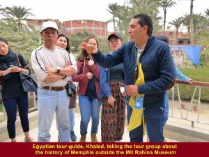 Egyptian tour-guide, Khaled, telling the tour group about the history of Memphis outside the Mit Rahina Museum
