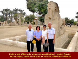 Right to left: Writer, wife. sister-in-law and brother standing in front of Egypt's seond largest Sphinx in the open air museum of Mit Rahina Museum