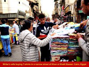 Writer;s wife buying T-shirts at Khan el Khalil Bazaar, Cairo