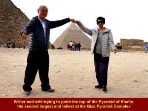 "Writer and wife trying to ""touch"" the top of the Pyramid of Khafre"