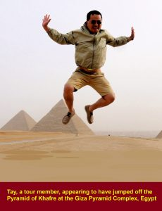 Tay, a tour member, appearing to have jumped off a pyramid