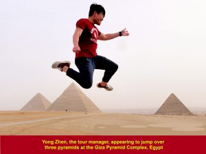 Yong Zhen, the tour manager, appearing to jump over three pyramids