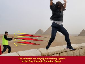 """Tan and wife playing an exciting """"game"""" at the Giza Pyramid Complex, Egypt"""