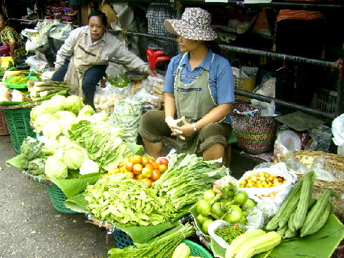 A vegetable seller at Warorot Market, Chiang Mai